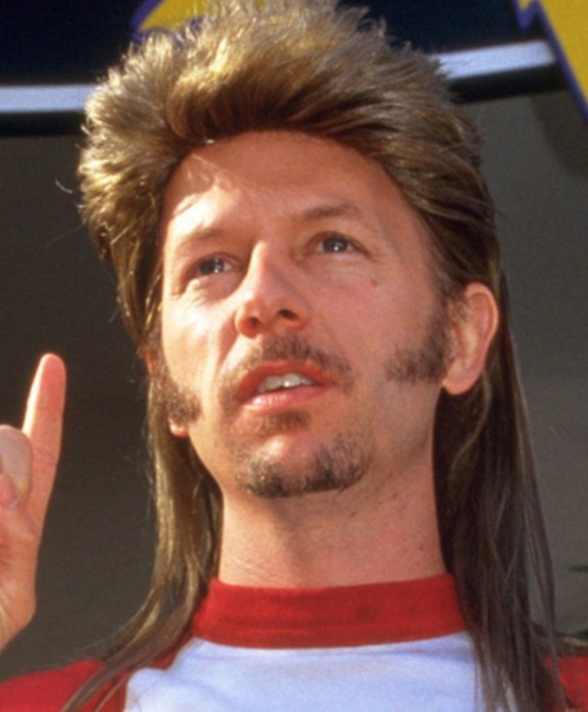 Joe Dirt Acted by David Spade, with accompanying acid washed jeans and dreams of a '67 Plymouth GTX Hemi